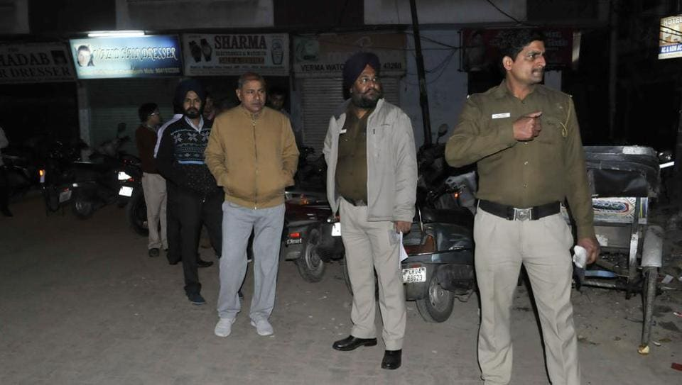 Police team at the crime scene in Sector 45-C market inChandigarh on Wednesday.