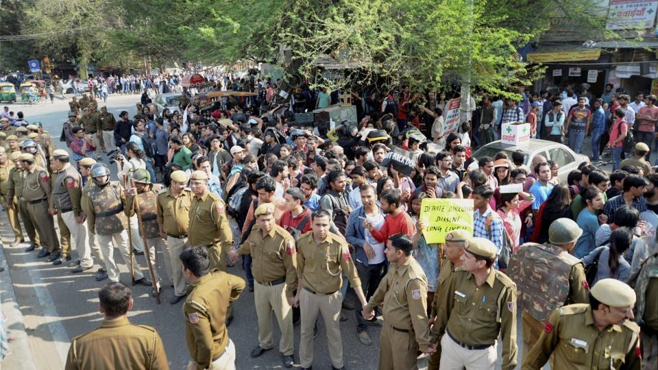 AISA members marching towards Maurice Nagar police station to file a case against ABVP activists in New Delhi on Wednesday. (PTI)