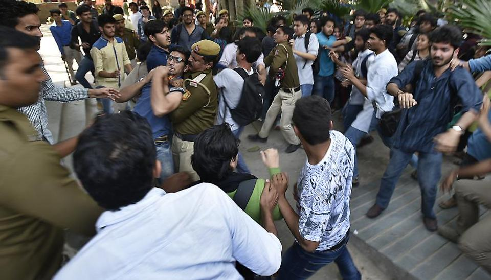 Students clash near Maurice Nagar police station on Wednesday.