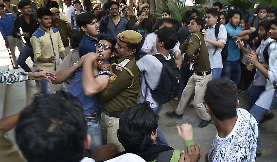 ABVP activists beating Ramjas students , after JNU student Umar Khalid's visit to Ramjas College was cancelled following protests by students, on Wednesday.
