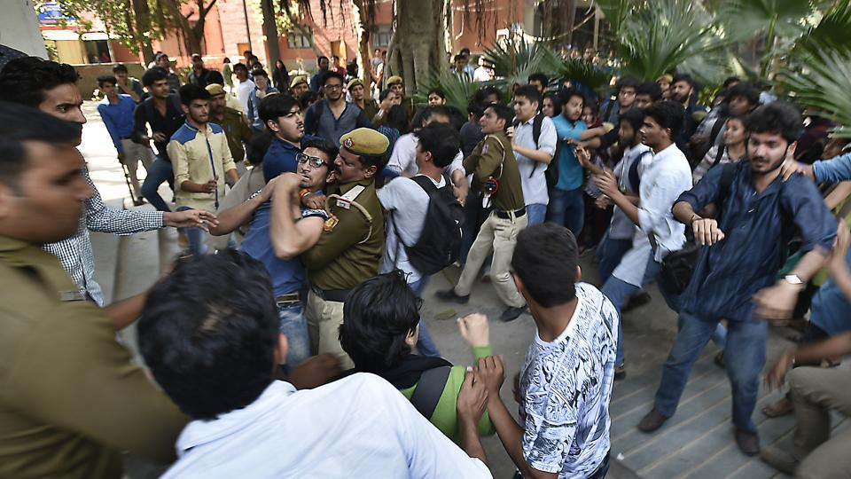 Activists allegedly of the Akhil Bharatiya Vidyarthi Parishad  beating Ramjas students , after JNU student Umar Khalid's visit to Ramjas College was cancelled following protests by students. at the Delhi University in New Delhi, India, on Wednesday, February 22, 2017.