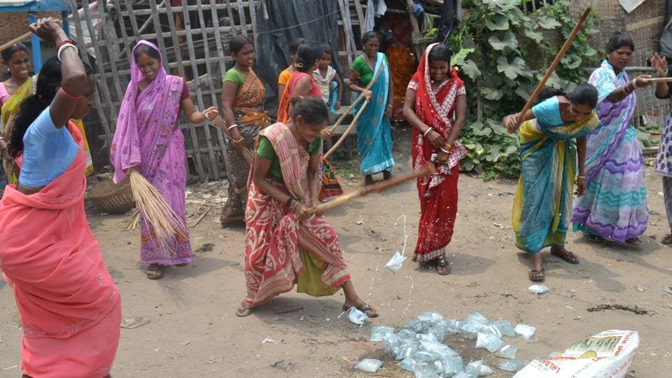 Women destroying pouched liquor near Steel gate in Dhanbad