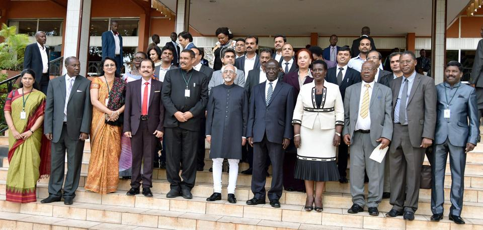 Vice president Hamid Ansari and members of the Indian delegation with Ugandan officials at a meeting in Kampala on Wednesday.