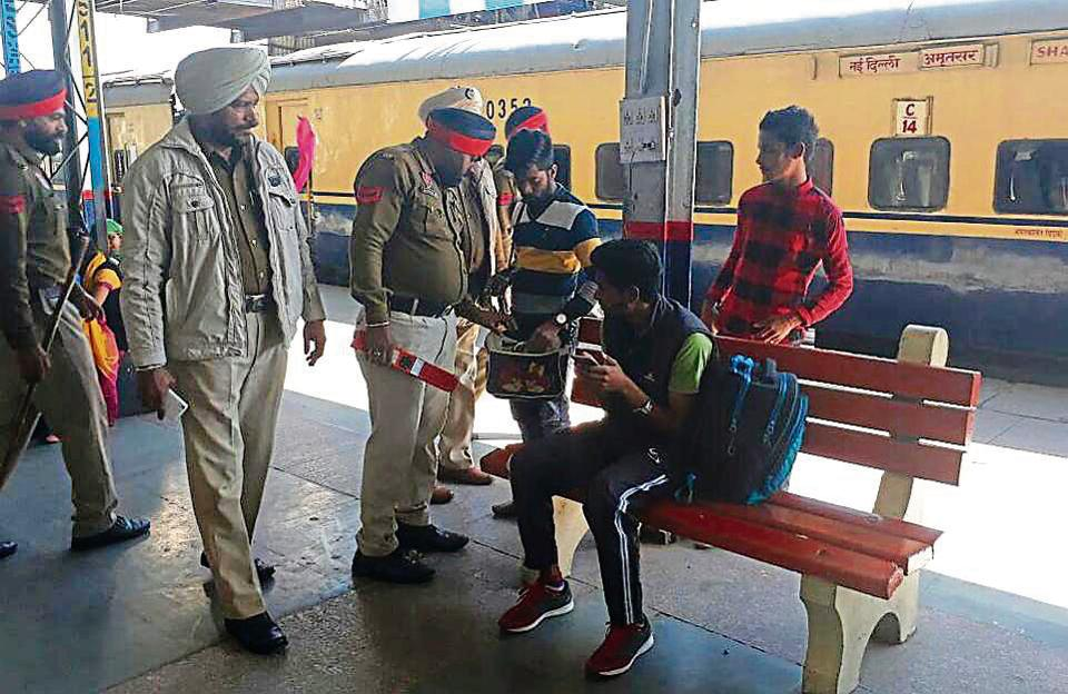 Police personnel checking luggage of the passengers at the railway station in Amritsar on Thursday.