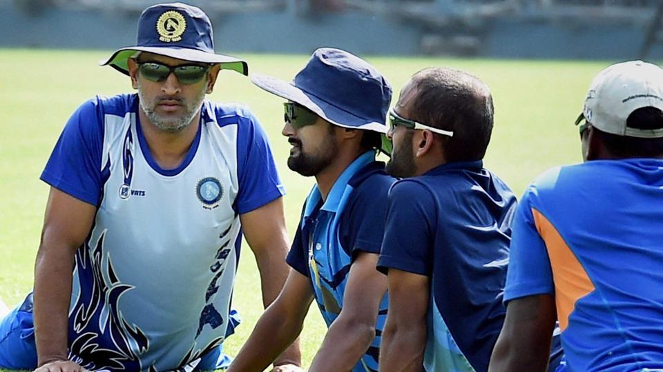 Mahendra Singh Dhoni with his Jhankhand teammates during a training session at Eden Gardens in Kolkata on Thursday for the Vijay Hazare Trophy.