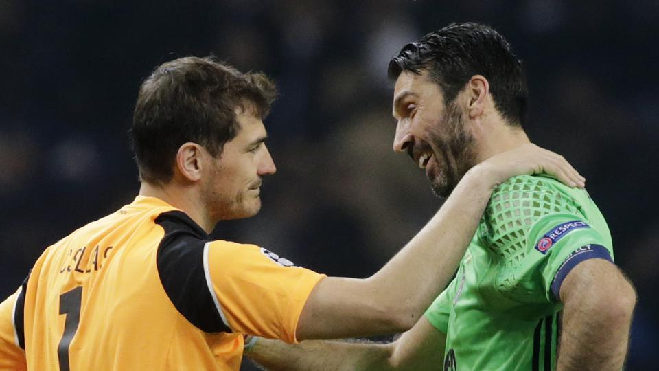 Juventus' Gianluigi Buffon (right) with FC Porto's Iker Casillas after their UEFA |Champions League match.