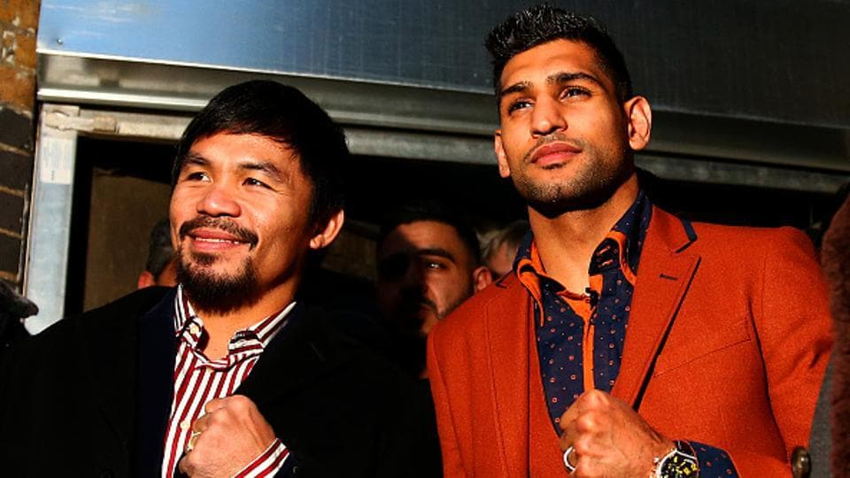Manny Pacquiao and Amir Khan pose after holding discussions about the possibility of a future fight in London.