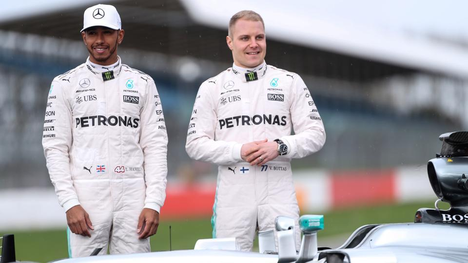 Mercedes' Lewis Hamilton and Valtteri Bottas pose during the launch of the new car.