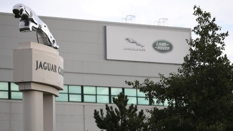 Signs are seen outside the Jaguar Land Rover plant at Halewood in Liverpool, northern England