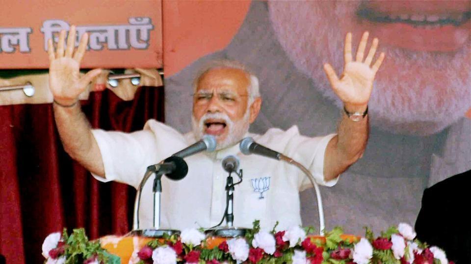 Prime Minister Narendra Modi addressing a Parivartan Sankalp Rally at Phulpur in Uttar Pradesh on Monday.