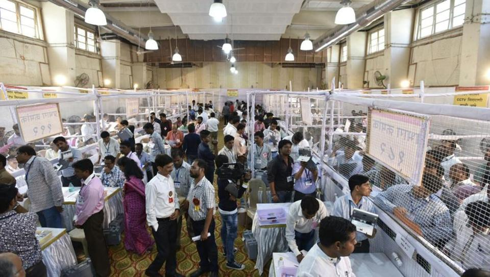 Polling agents at a counting centre at Dr Antonia High School, Dadar, in Mumbai. (kunal patil/ht photo)