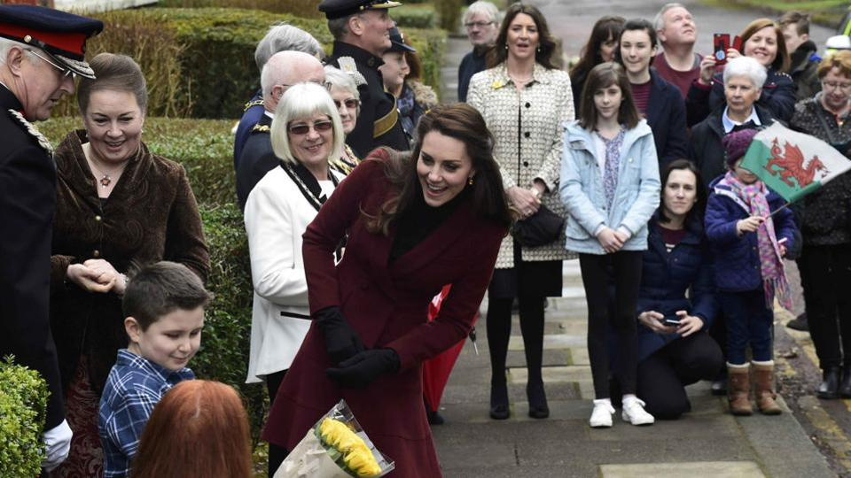Britain's Catherine, Duchess of Cambridge, interacts with children at the Palm Suite, in Pontypool. (Rebecca Naden / REUTERS)