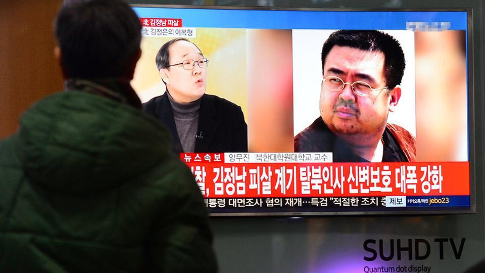 People watch a TV screen broadcasting a news report on the assassination of Kim Jong Nam, the older half brother of the North Korean leader Kim Jong Un, at a railway station in Seoul, South Korea, February 14.