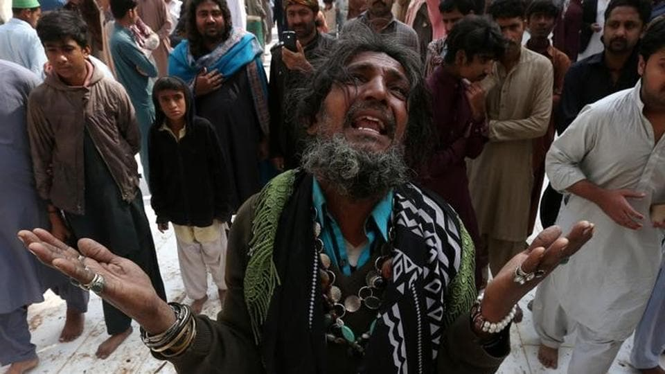 A man mourns the death of a relative who was killed in a suicide blast at the shrine of Sufi saint  Lal Shahbaz Qalandar, on February 18, in Sehwan Sharif, Pakistan's southern Sindh province.