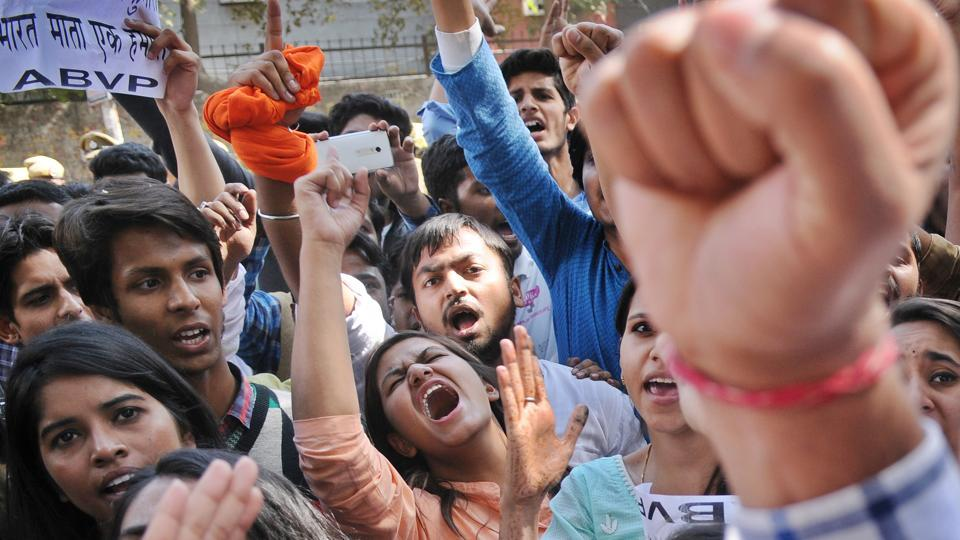 ABVP members shout slogans against AISA and Umar Khalid in the Art Faculty of Delhi University campus, in New Delhi, India, on Thursday, February 23, 2017. Memebrs of the group said that they are against anti-nationals and will continue to protest one day after clashes broke out between two student organizations outside Ramjas college campus yesterday in Delhi University.  (Burhaan Kinu/HT PHOTO)