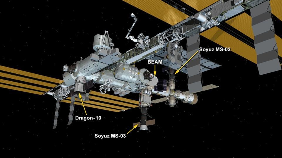 This NASA handout illustration image obtained February 23, 2017 shows the SpaceX Dragon attached to the Space Station Harmony Module. The SpaceX Dragon was successfully installed to the Harmony module a few hours after it was captured with the Canadarm2 on February 23, 2017.