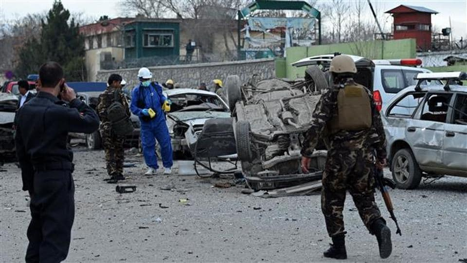 An Afghan official says a suicide car bomb has killed at least two soldiers and wounded three others in southern Helmand province.
