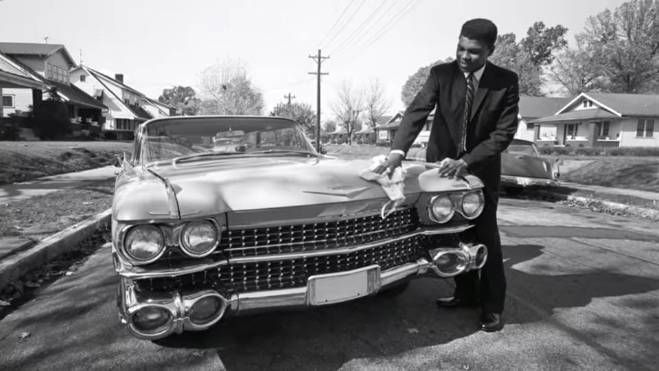 The ad also features Mohammad Ali cleaning his Caddy.