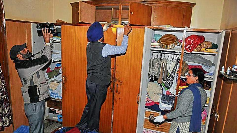 Forensic experts taking fingerprints from the crime spot at the Lajpat Nagar locality in Jalandhar on Thursday.