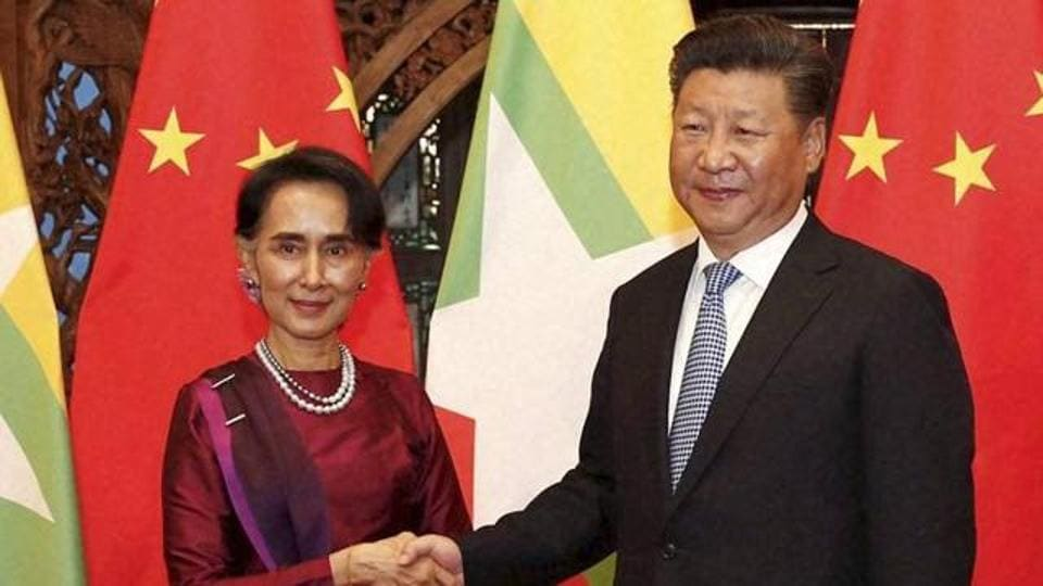 A file photo of Myanmar State Counselor Aung San Suu Kyi with Chinese Premiere Xi Jinping. China is Myanmar's biggest trading partner, and the Chinese business presence is growing as the fledgling democracy opens up.