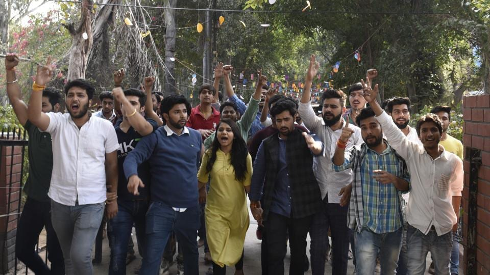 Students and members of ABVP shout slogans at Ramjas College in New Delhi,