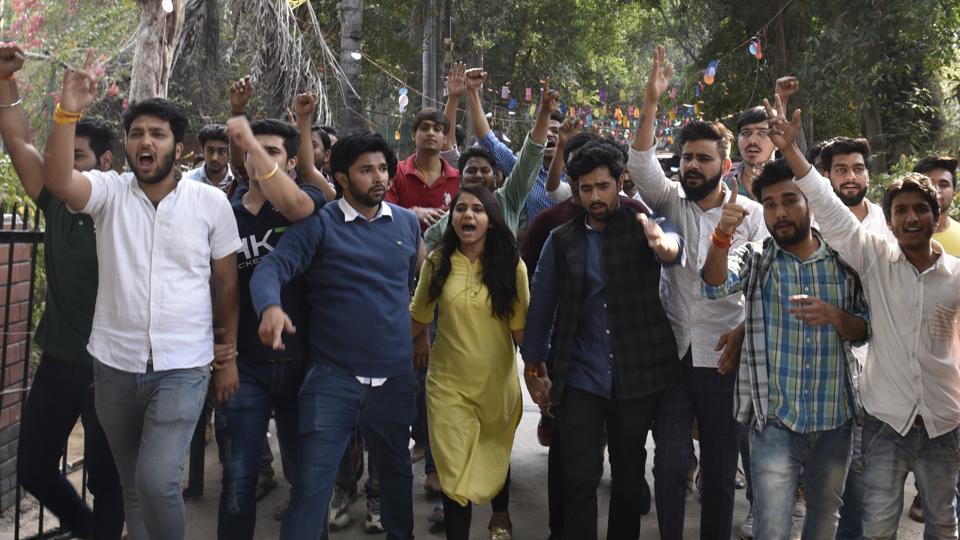 Students and members of ABVP shout slogans at Ramjas College on Tuesday.
