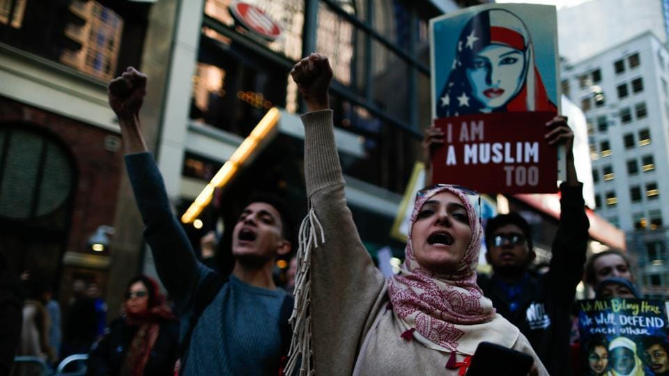 People take part in a rally dubbed 'I Am A Muslim Too' in a show of solidarity with American Muslims at Times Square.