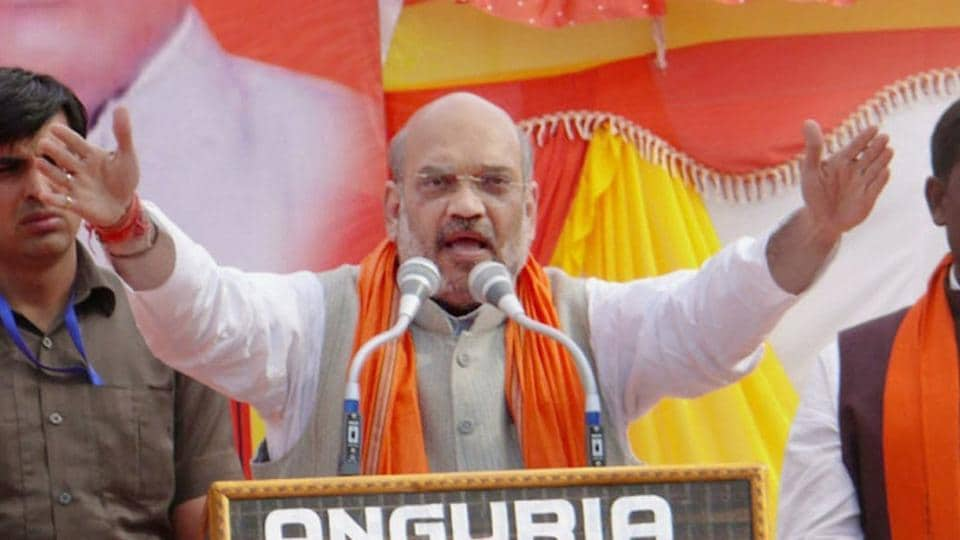 BJP president Amit Shah addresses an election rally in Azamgarh.