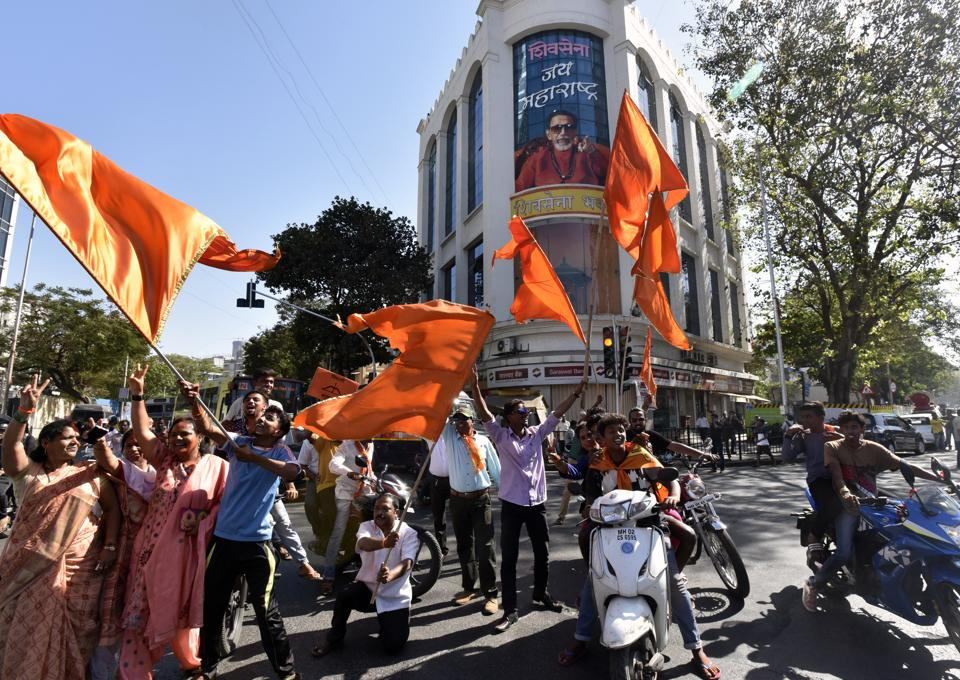 Shiv Sena supporters celebrate theIR victory outside Shiv Sena Bhavan at Dadar.