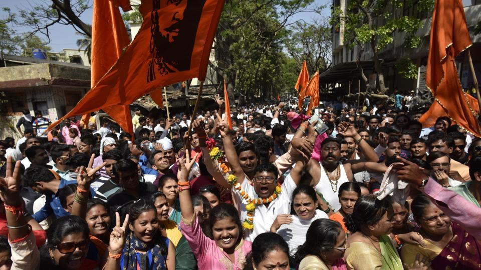 Shiv Sena supporters celebrate outside BMC vote counting centre at Ghatkopar in Mumbai on Thursday.
