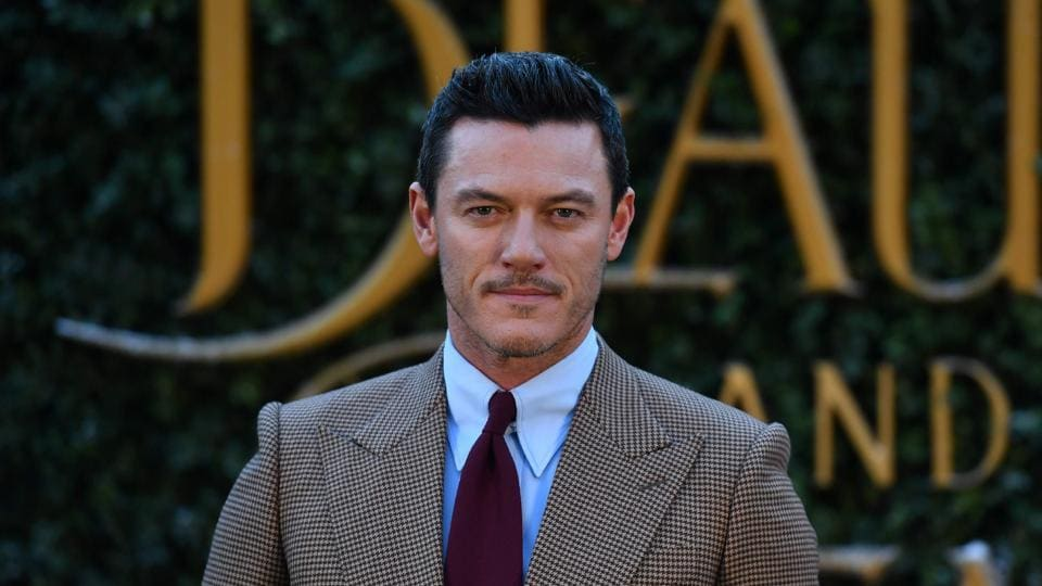 Welsh actor Luke Evans gelled-up hair are to swoon-worthy. He plays the villain, Gaston in the film. (AFP)