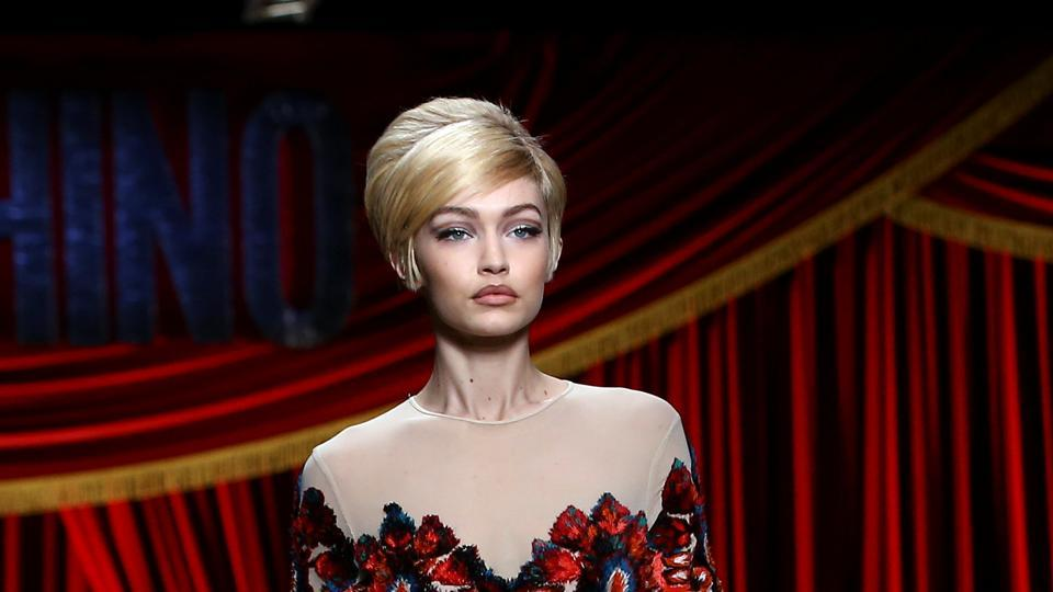 Model Gigi Hadid presents a creation from Moschino's Autumn/Winter 2017 women's collection.