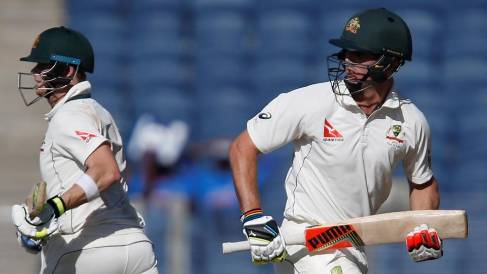Australia's captain Steve Smith and Mitchell Marsh run between the wickets on Day 2 of the Pune Test on Friday. Live streaming of the India vs Australia is available online