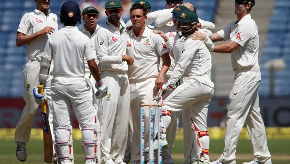 Steve O'Keefe's 6/35 and Steve Smith's  59* helped Australia dominate India on the second day of first Test in Pune.  (REUTERS)