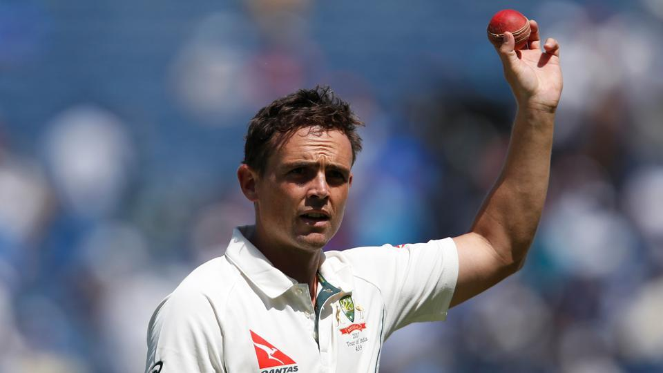Australia's Steve O'Keefe holds up the ball after taking six wickets in India's first innings, in Pune on Friday.