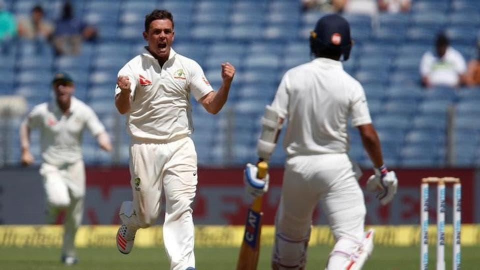 Australia's Steve O'Keefe celebrates the wicket of India's Ajinkya Rahane.