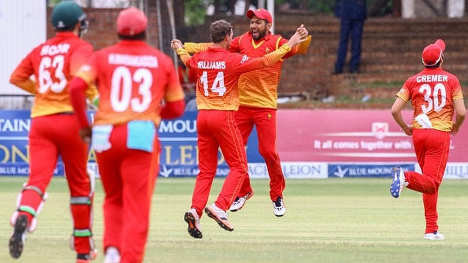 Zimbabwe players celebrate after taking a wicket against Afghanistan in Harare.