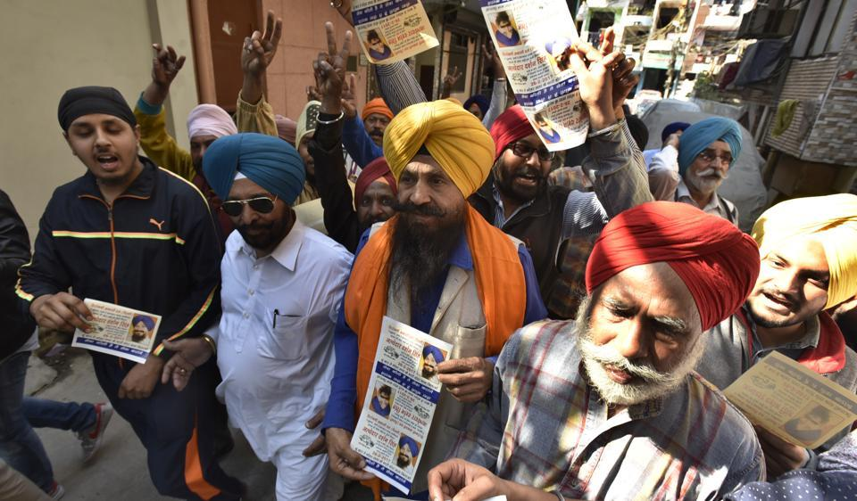 Members of Shiromani Akali Dal (Delhi) campaign for the Delhi Sikh Gurdwara Management Committee (DSGMC) elections in New Delhi  on Friday.