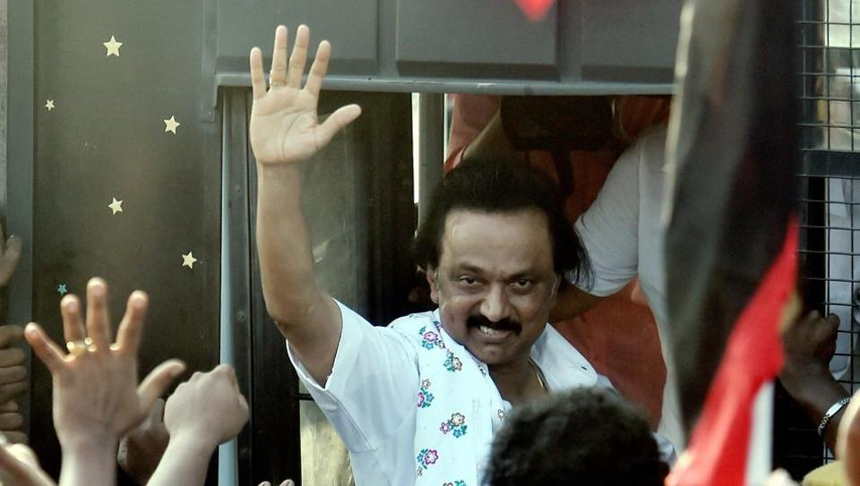 DMK working president MK Stalin greets his supporters after being detained by police for staging a protest in Chennai .