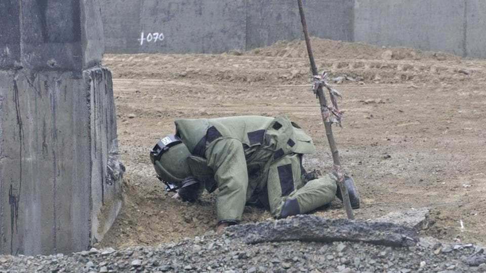 Bomb Disposal Squad defuses an IED.
