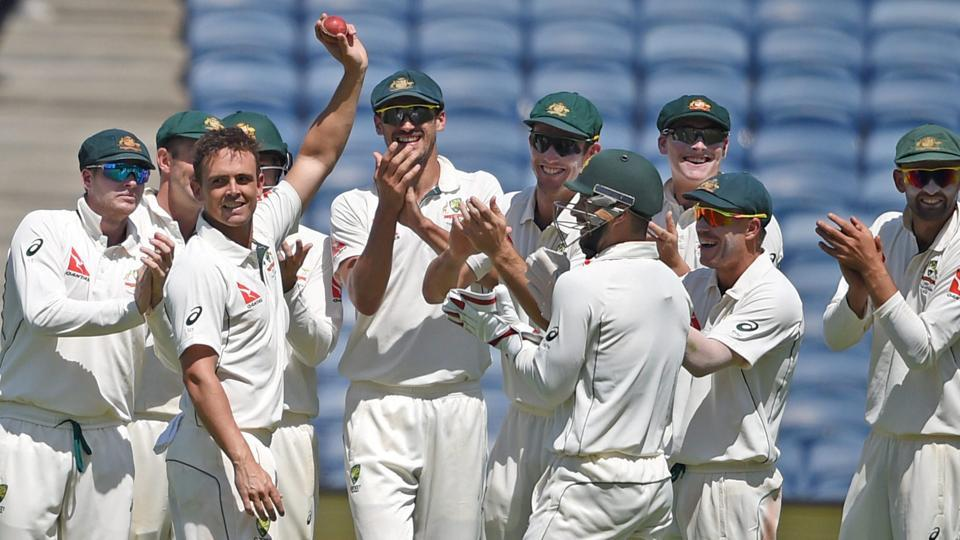 Australian bowler Steve O'Keefe celebrates his six wickets during the first test match played against India in Pune.
