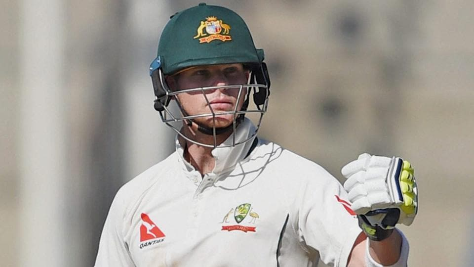 Australia batsman Steve Smith celebrates his half century during the 2nd day of the first test match against India.