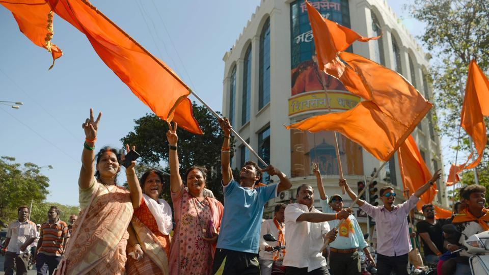 Shiv Sena members celebrate after their victory in the BMC elections in Mumbai on Thursday.