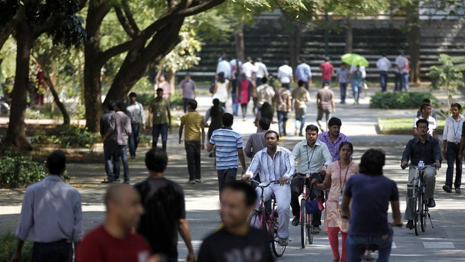 In this  file photo, Infosys Technologies employees move through the headquarters during a break in Bangalore. Senior IT industry leaders claim any curb on H-1B visa by the Donald  Trump administration will severely impact the US economy.
