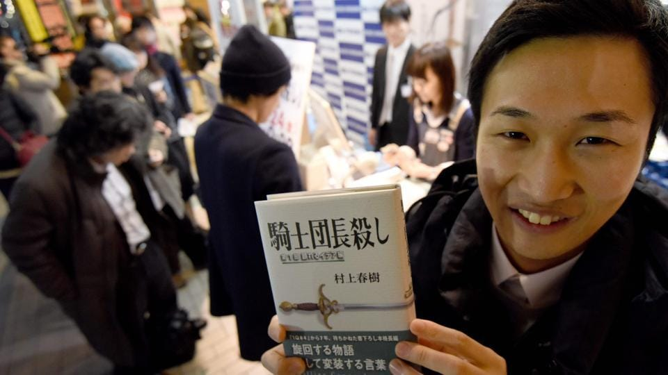 A fan of Haruki Murakami holds his new novel at a bookstore in Tokyo.