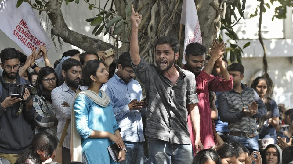 JNU student leader Umar Khalid speaks during a protest held by the All India Students Association (AISA) and Jawaharlal Nehru University students demanding the arrest of Akhil Bharatiya Vidyarthi Parishad (ABVP) members at the police headquarters in New Delhi on Thursday.