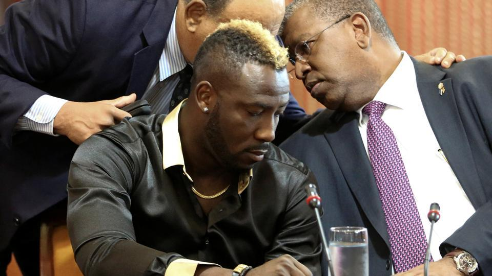 West Indies all-rounder Andre Russell during a meeting of an independent anti-doping tribunal at the Jamaica Conference Centre next to his lawyers, in Kingston on January 31.