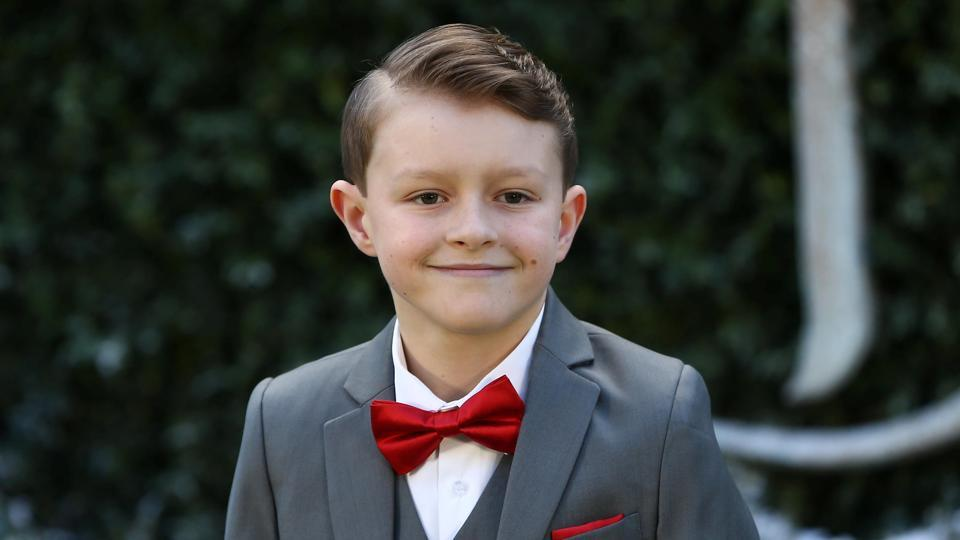 Nathan Mack rocked a pretty red bow tie. He plays the adorable tea cup Chip. (REUTERS)