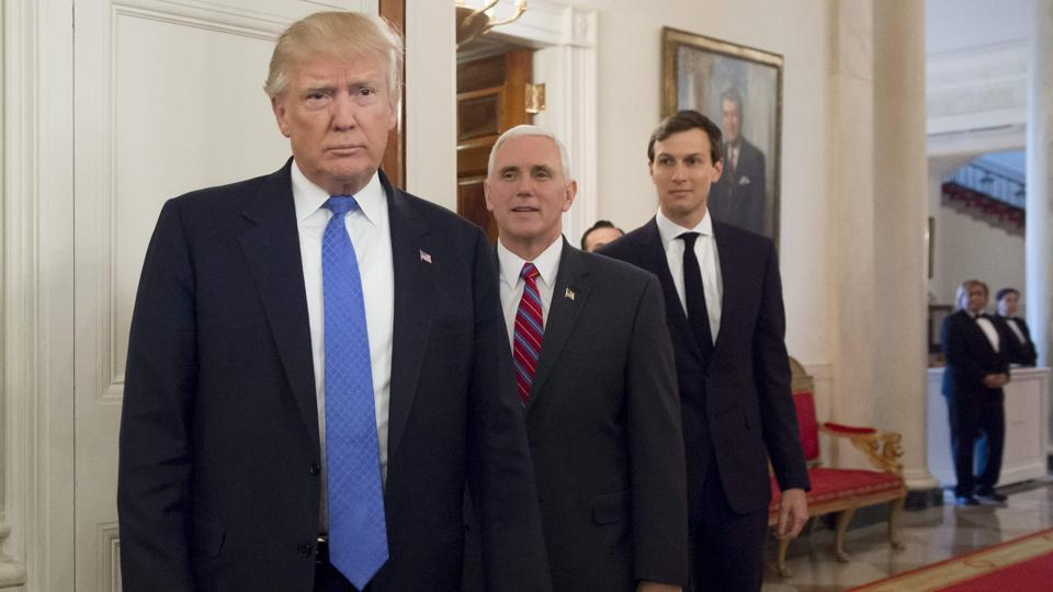 US President Donald Trump arrives alongside Vice President Mike Pence (C) and White House Senior Advisor Jared Kushner (R) during a meeting with manufacturing CEOs in the State Dining Room at the White House in Washington, DC, February 23.