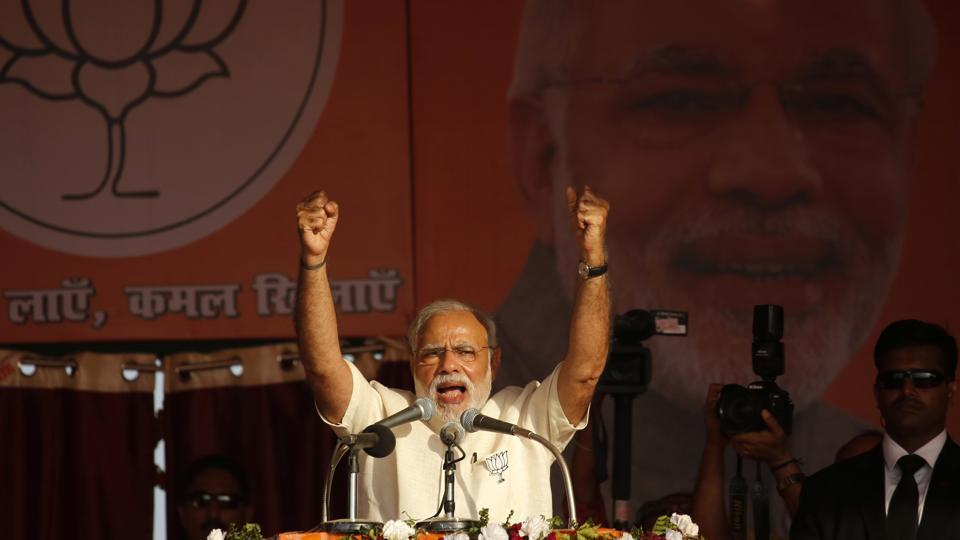 Prime Minister Narendra Modi gestures as he addresses an election rally in Allahabad on February 20.